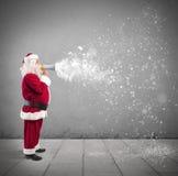 Santa Claus med megafonen Arkivfoto