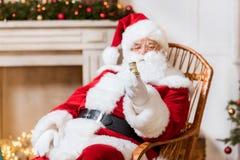 Santa Claus med rulle av pengar royaltyfria foton