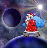 Santa Claus med säcken av gåvor går Arkivfoto