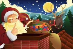 Santa Claus med släden som är full av julklappar Arkivfoton