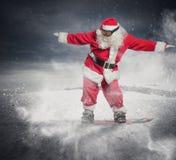 Santa Claus med snowboarden Arkivfoton