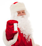 Santa Claus with a medicine. Close up of Santa Claus with a bottle for pills isolated on white. Sharpness on the bottle drive Stock Photography