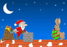 Santa Claus Meets The Easter Bunny On A Roof Royalty Free Stock Photo
