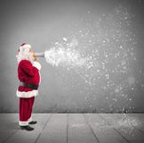 Santa Claus with megaphone Stock Photo