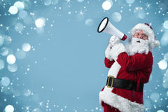 Santa Claus with a megaphone. Santa Claus shouting using megaphone Royalty Free Stock Photos