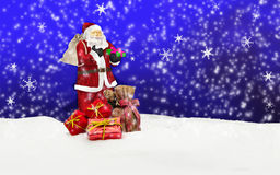 Santa claus - merry christmas. Santa claus with sack in snow - blue Royalty Free Stock Photo