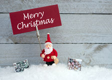 Santa Claus with Merry Christmas sign Royalty Free Stock Image
