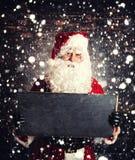 Santa Claus met chalboard Stock Foto
