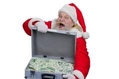 Santa Claus met een geval van geld stock foto's