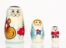 Santa Claus met sneeuwmeisje en sneeuwman Stock Afbeelding