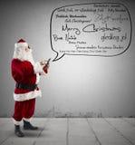 Santa Claus met Vrolijk Kerstmisbericht Stock Foto