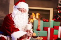 Santa Claus with milk and chocolate chip cookies Stock Photo