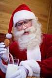 Santa Claus With Milk And Cookies Stock Foto's