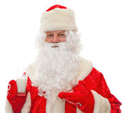 Santa Claus with milk in the hands of Royalty Free Stock Photography