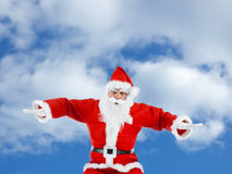 Santa Claus mimics a plane Royalty Free Stock Photos