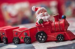 Santa claus on miniature toy train. Closeup of santa claus on miniature toy train Royalty Free Stock Photography