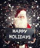 Santa Claus mit chalboard Lizenzfreies Stockfoto