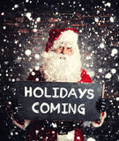 Santa Claus mit chalboard Stockfoto