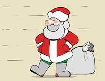 Santa Claus mit einem großen Sack Weihnachtsgeschenken Lizenzfreie Stockfotografie