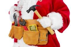 Santa Claus mit einem Werkzeuggurt Lizenzfreie Stockfotos