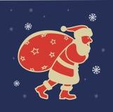 Santa Claus mit einer Tasche der Geschenkikone auf dem Hintergrund von Schneeflocken Lizenzfreie Stockfotografie