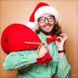 Santa Claus mit einer Tasche von Geschenken Stockfoto