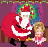 Santa Claus mit einer Tasche von Geschenken Lizenzfreie Stockfotos