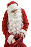 Santa Claus mit einer Tasche von Geschenken Stockfotos