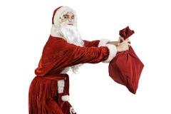 Santa Claus mit einer Tasche von Geschenken Lizenzfreies Stockfoto