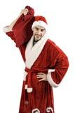 Santa Claus mit einer Tasche von Geschenken Stockbild