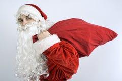 Santa Claus mit einer Tasche von Geschenken Stockfotografie