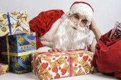 Santa Claus mit Geschenken Stockfotografie