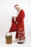 Santa Claus mit Geschenken Stockbild