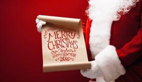 Santa Claus mit Glückwunsch Stockfotografie