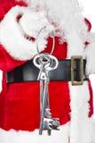 Santa Claus mit Grundstellungstaste Lizenzfreies Stockfoto