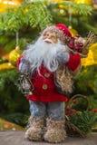 Santa Claus mit Laterne und einer Tasche Lizenzfreie Stockbilder