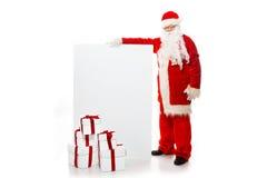 Santa Claus mit vielen Geschenkboxen Stockfoto