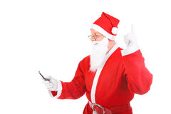 Santa claus with mobile phone Royalty Free Stock Photography