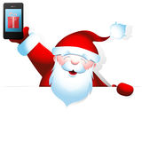 Santa Claus with mobile phone and blank banner Royalty Free Stock Photography