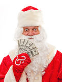 Santa Claus with the money in the hands of. Close up of Santa Claus with money isolated on white Stock Image