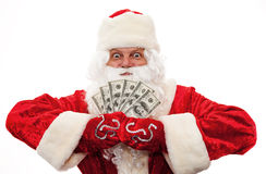 Santa Claus with the money in the hands of Royalty Free Stock Photos