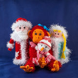 Santa Claus and monkey with snow Maiden and snowman. Knitting simbol.  stock photo