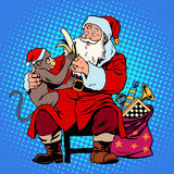 Santa claus monkey symbol new year 2016. Pop art retro style. Christmas character with the animal on his knees. Gives the monkey a banana Stock Image