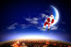 Santa on the moon Royalty Free Stock Photo