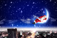Santa on the moon Royalty Free Stock Images
