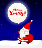 Santa Claus with moon balloon on snow roof. Royalty Free Stock Photography
