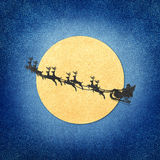 Santa Claus  And Moon recycled papercraft. Santa Claus On Sledge With Deer And Moon recycled papercraft Stock Image