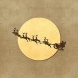 Santa Claus  And Moon recycled papercraft. Santa Claus On Sledge With Deer And Moon recycled papercraft Royalty Free Stock Photo