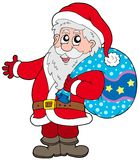 Santa Claus with more gifts Stock Photo