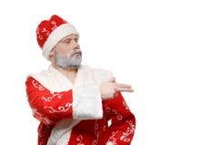 Santa Claus mostra sua mão à direita, um fundo branco fotografia de stock royalty free